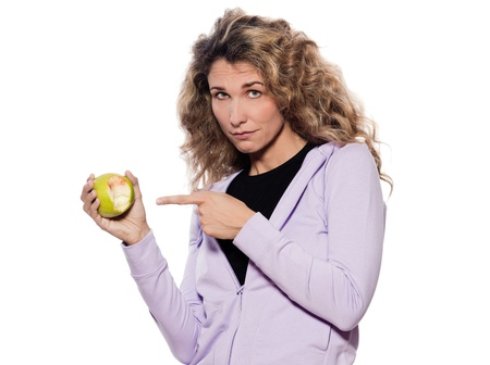 gingivitis: caucasian woman sad point apple portrait isolated studio on white background