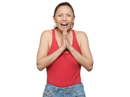 Portrait of cute happy expressive woman laughing in studio isolated on white background