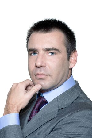 arrogancia: Closeup retrato de un hombre de negocios serio guapo en el estudio sobre fondo blanco aislado Foto de archivo