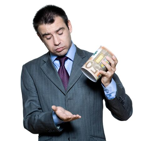 broke: Portrait of sullen  businessman with an empty  money box  in studio on isolated white background