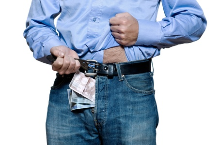 prostitution: Detail of denim jeans with money inside in studio isolated on white background