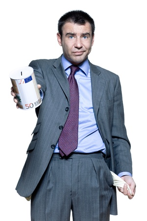 Portrait of businessman holding money box and showing empty pocket in studio on isolated white background photo