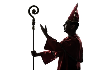 priest: one man cardinal bishop silhouette saluting blessing in studio isolated on white background