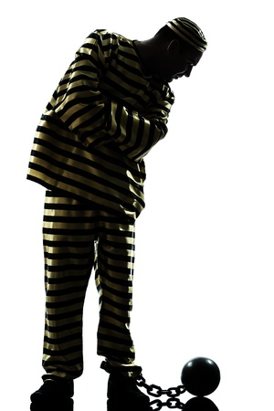 one caucasian man prisoner criminal with chain ball in studio isolated on white background photo