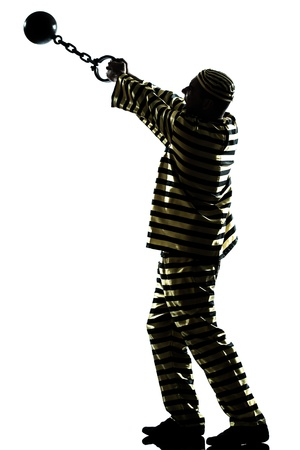 one caucasian man prisoner criminal escaping with chain ball in studio isolated on white background photo