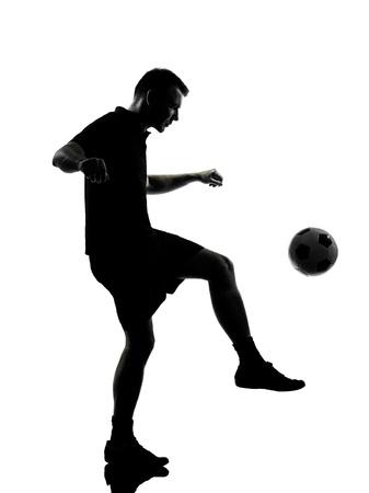 indoor soccer: un jugador de f�tbol en el estudio de la silueta del hombre aislado en el fondo blanco Foto de archivo