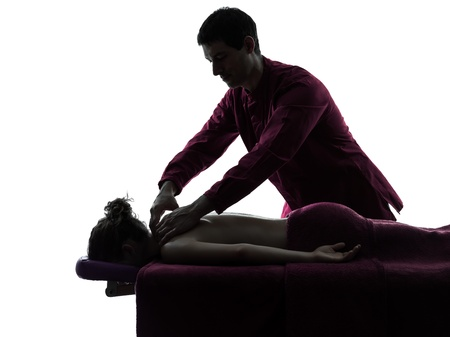 man woman back massage in silhouette studio on white background photo
