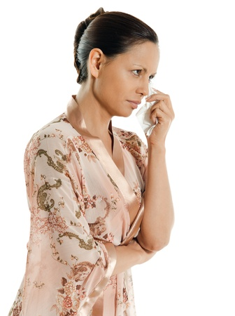 woman 40 years: Portrait of pensive Asian woman crying and looking away in studio isolated on white background Stock Photo