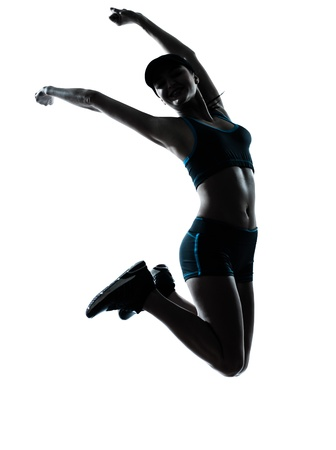 jogger: one caucasian woman runner jogger jumping happy jumping in silhouette studio isolated on white background