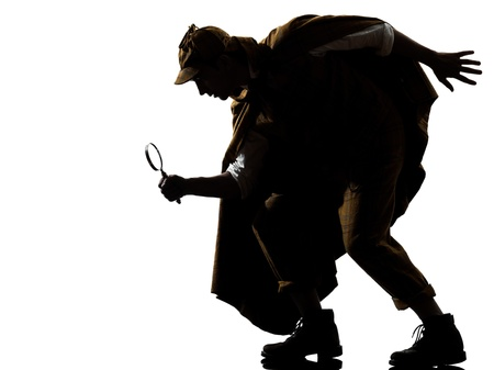 private detective: sherlock holmes silhouette in studio on white background