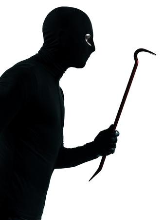 ladron: ladr�n criminal celebraci�n portait palanca en el estudio de la silueta aislado en el fondo blanco Foto de archivo