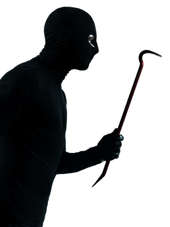 looting: thief criminal holding crowbar portait in silhouette studio isolated on white background