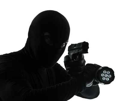 thief criminal in silhouette studio isolated on white background photo
