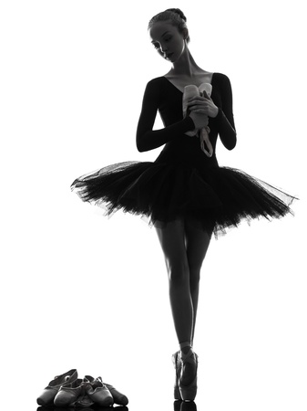 one caucasian young woman ballerina ballet dancer dancing with tutu in silhouette studio on white background Stock Photo - 15800651