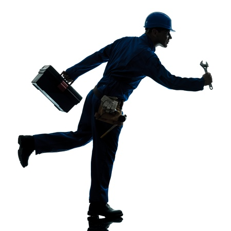one caucasian repairman worker running urgency silhouette in studio on white background photo