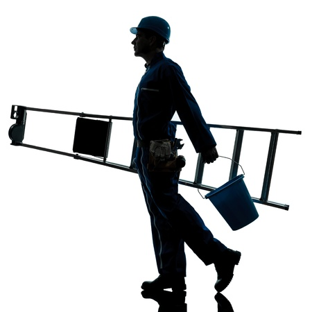 one caucasian repairman worker ladder walking silhouette in studio on white background photo