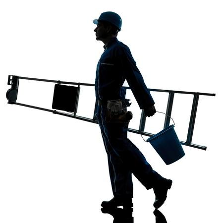 class maintenance: one caucasian repairman worker ladder walking silhouette in studio on white background Stock Photo