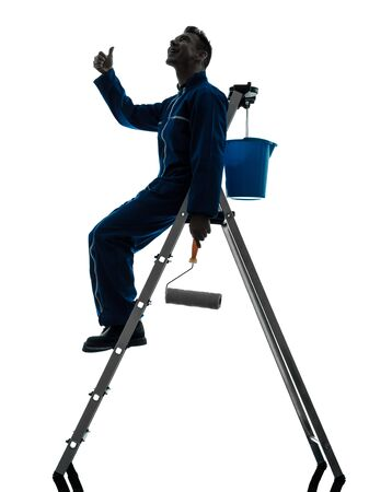 one caucasian man house painter worker silhouette in studio on white background Stock Photo - 15800552