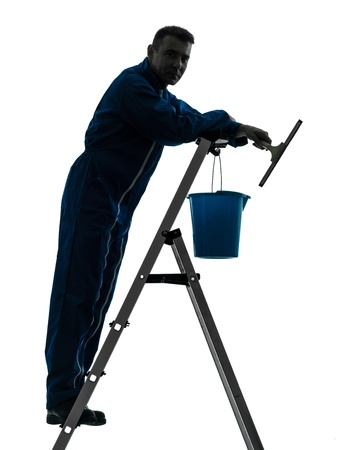 indoor shot: one caucasian man house worker janitor cleaning window cleaner silhouette in studio on white background