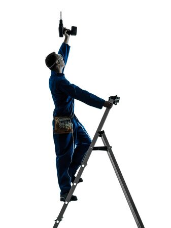 class maintenance: one caucasian man construction worker holding drill silhouette in studio on white background