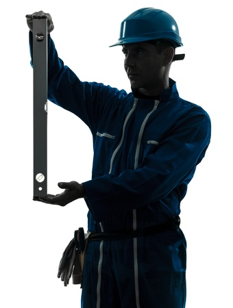 class maintenance: one caucasian man construction worker holding level silhouette in studio on white background