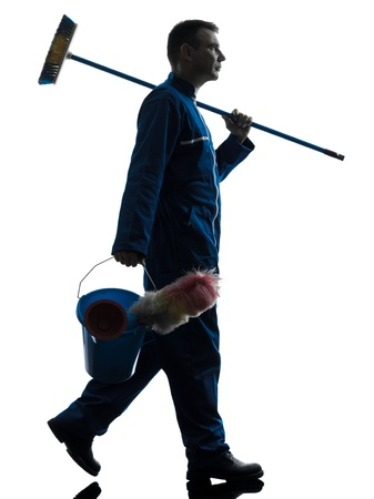 indoor shot: one caucasian janitor cleaner cleaning silhouette in studio on white background