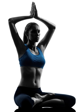lotus pose: one caucasian woman exercising yoga meditating sitting hands joined in silhouette studio isolated on white background