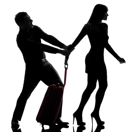 restraining: one caucasian couple dispute separation woman leaving and man holding back in studio silhouette isolated on white background