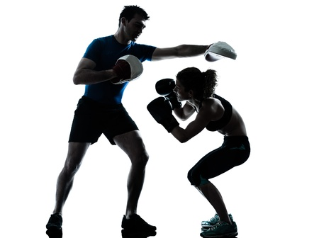 one caucasian couple man woman personal trainer coach man woman boxing training silhouette studio isolated on white background photo
