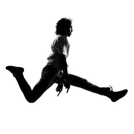 studio b: full length silhouette of a young man dancer dancing funky hip hop r b on  isolated  studio white background