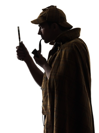 private investigator: sherlock holmes silhouette in studio on white background