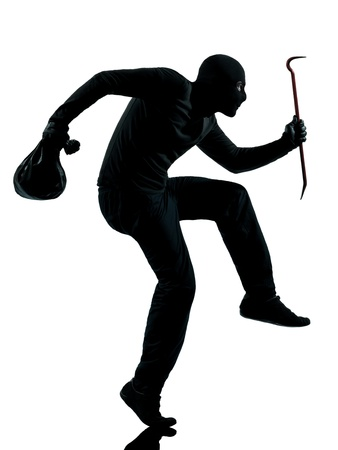 looting: thief criminal walking quiet in silhouette studio isolated on white background