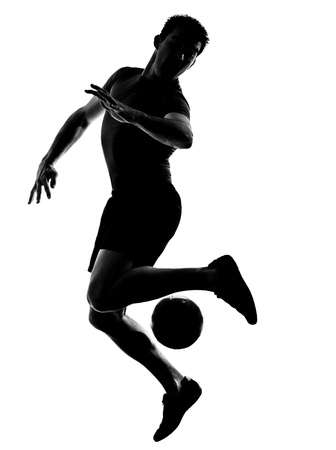 one caucasian man playing soccer football player silhouette  in studio isolated on white background photo