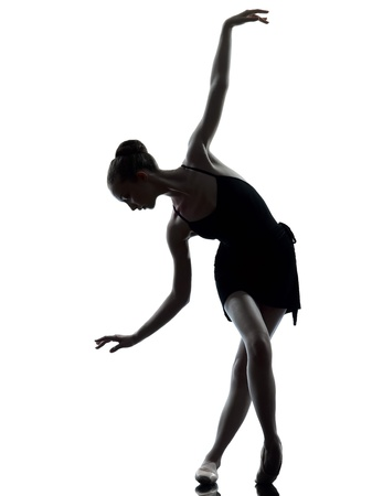 one caucasian young woman ballerina ballet dancer stretching warming up in silhouette studio on white background 版權商用圖片