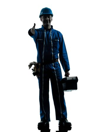 one caucasian repairman worker salutingsilhouette in studio on white background photo