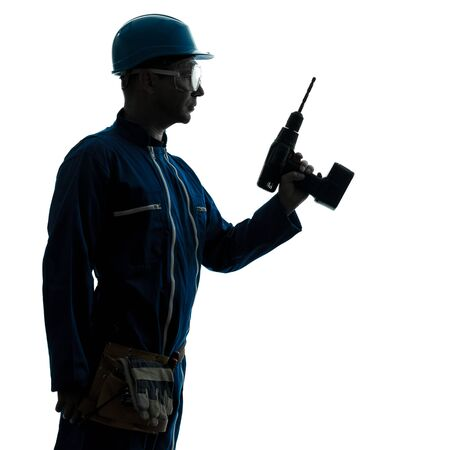 one caucasian man construction worker holding drill silhouette in studio on white background photo