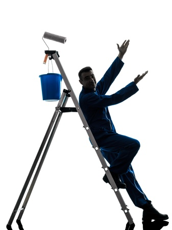 one caucasian man house painter worker silhouette in studio on white background photo