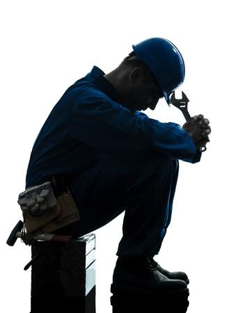 class maintenance: one caucasian repairman worker sad fatigue failure  silhouette in studio on white background Stock Photo