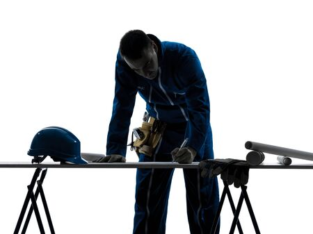 class maintenance: one caucasian man construction  Architect working plans silhouette in studio on white background