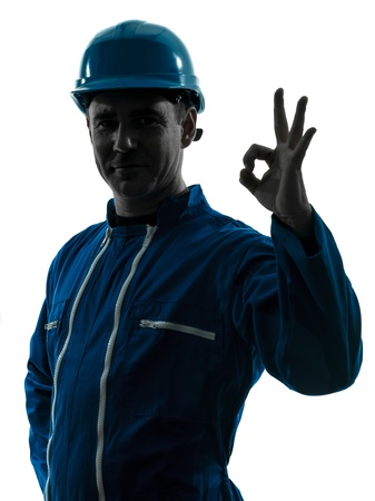 one caucasian man construction worker smiling silhouette portrait okay gesture in studio on white background photo