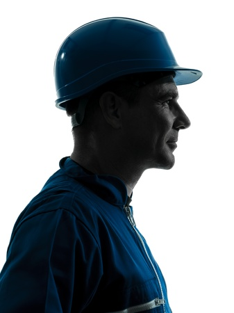 one caucasian man construction worker smiling silhouette portrait in studio on white background photo