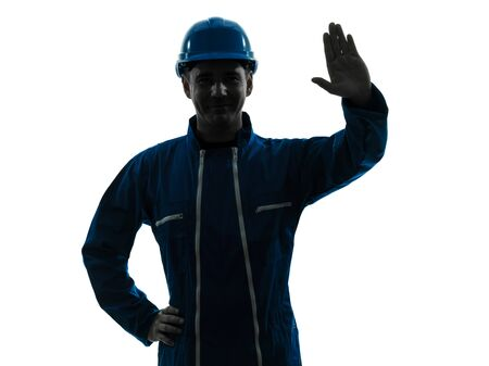 one caucasian man construction worker saluting smiling silhouette portrait in studio on white background photo