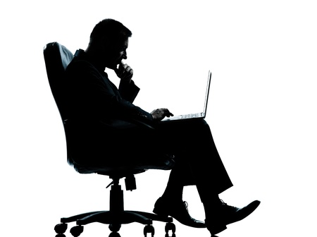 one caucasian business man computer computing sitting in armchair silhouette Full length in studio isolated on white background photo