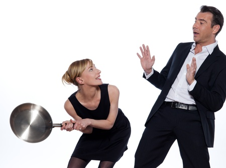 relationship problem: beautiful caucasian couple on studio white background in funny conflict