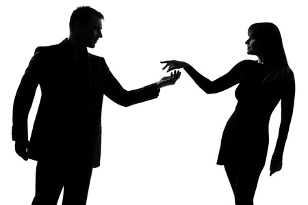 seduction: one caucasian couple man holding out inviting hand in hand  woman in studio silhouette isolated on white background