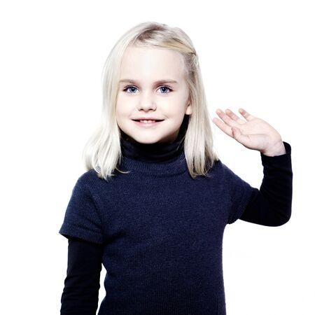 litle: studio portrait of a caucasian cute litle girl saluting Stock Photo