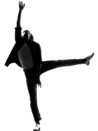 funk: full length silhouette of a young man dancer dancing funky hip hop r&b on  isolated  studio white background