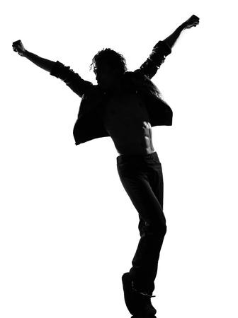 bailarines silueta: silueta de cuerpo entero de un hombre joven bailarín de hip hop bailando cobarde r & b en estudio aislado fondo blanco