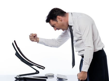 angry computer: caucasian man and a computer display monitor on isolated white background expressing  bug  conflict rejection concept