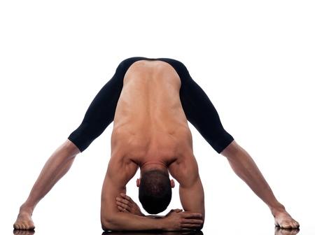 Man yoga Prasarita Padottanasana Wide-Legged Forward Bend gymnastic warming up isolated studio on white background photo